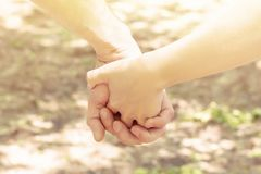 Hands hold hands. couple boy and girl clasped hands love meeting royalty free stock photography