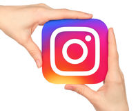 Hands hold Instagram icon printed on paper. Kiev, Ukraine - January 20, 2016: Hands hold Instagram icon printed on paper. Instagram is an online mobile photo royalty free stock photos