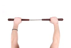 Hands hold martial arts nunchaku. Stock Photos