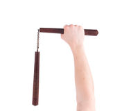 Hands hold martial arts nunchaku. Stock Photography