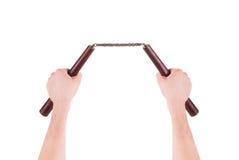 Hands hold martial arts nunchaku. Stock Images