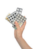 Hands hold medicine aspirin painkiller tablet pills Royalty Free Stock Photos