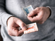 Hands hold Moldovan leu. Selective focus. Shallow DOF Stock Image