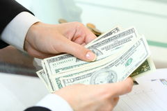 Hands hold money Royalty Free Stock Images