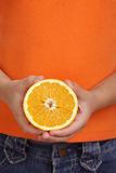 Hands hold orange Royalty Free Stock Photo
