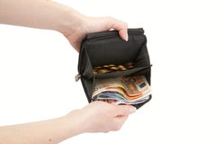 Hands hold out an wallet with money. On white background Royalty Free Stock Images