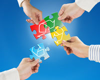 Hands hold puzzles with recycle symbol in blue sky and sunlight Royalty Free Stock Photography