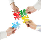 Hands hold puzzles with recycle symbol isolated in white backgro. Und Royalty Free Stock Photos