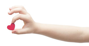 Hands hold a red heart Stock Image