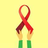 Hands Hold Red Ribbon World AIDS Day Awareness Stock Photography