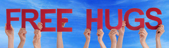 Hands Hold Red Straight Word Free Hugs Blue Sky Stock Photos