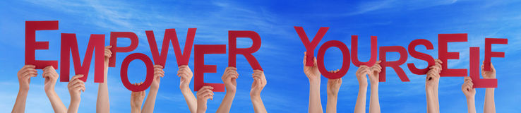 Hands Hold Red Word Empower Yourself Blue Sky. Many Caucasian People And Hands Holding Red Letters Or Characters Building The English Word Empower Yourself On Stock Photos