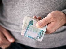 Hands hold rubles Royalty Free Stock Image