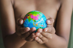 Hands hold small globe Royalty Free Stock Photo