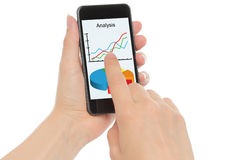 Hands hold smart phone with graphs Stock Photo