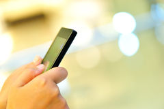 Hands hold smart phone in modern city Royalty Free Stock Photography