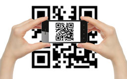 Hands hold smart phone with QR code Royalty Free Stock Image