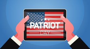 Hands Hold Tablet Computer With United States Flag National USA Patriot Day Holiday Banner Royalty Free Stock Photography
