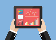 Hands hold tablet with flat simplistic inforgraphic charts on a Stock Photos