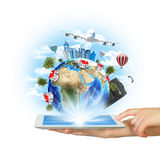 Hands hold tablet pc with Earth and buildings Stock Photos