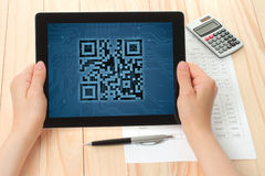 Hands hold tablet PC with QR code Royalty Free Stock Photo