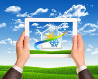 Hands hold tablet pc with weather icon. Man hands hold tablet pc with weather icon. Nature landscape as backdrop. Business concept stock images