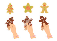 Hands hold traditional xmas cookies symbols: gingerbread, tree Royalty Free Stock Image