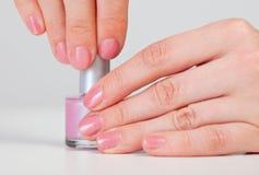 Hands hold a vial - nail polish Stock Image