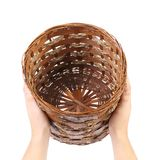 Hands hold vintage weave wicker basket Stock Photo