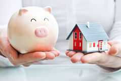 Free Hands Holding A Piggy Bank And A House Model Royalty Free Stock Images - 29557279
