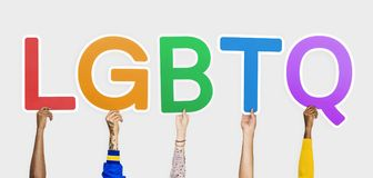 Hands holding the abbreviation LGBTQ stock photos