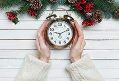 Hands holding alarm clock Stock Photography