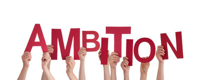 Hands Holding Ambition. Many Hands Holding the Red Word Ambition, Isolated stock photos