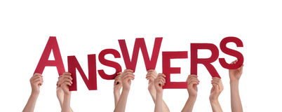 Hands Holding Answers. Many Hands Holding the Red Word Answers, Isolated royalty free stock photo