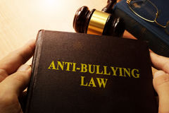 Hands holding Anti-Bullying Law. Royalty Free Stock Photography