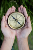 Hands holding  antique compass Stock Photography