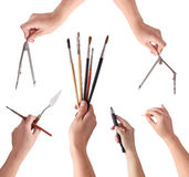 Hands holding an artist's tools Royalty Free Stock Photos