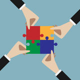 Hands holding assembled puzzle Stock Photos