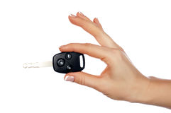 Hands holding an automobile key Stock Photo