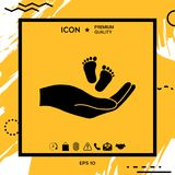 Hands holding baby foot. Element for your design Stock Images