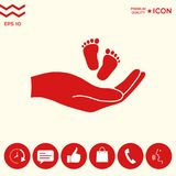 Hands holding baby foot. Signs and symbols - graphic elements for your design Royalty Free Stock Photography