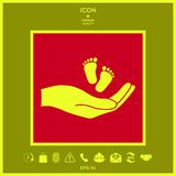 Hands holding baby foot. Signs and symbols - graphic elements for your design Royalty Free Stock Images