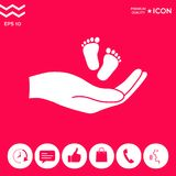 Hands holding baby foot. Signs and symbols - graphic elements for your design Stock Photos