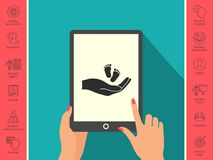 Hands holding baby foot. Signs and symbols - graphic elements for your design Stock Photo