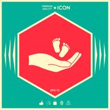 Hands holding baby foot. Signs and symbols - graphic elements for your design Royalty Free Stock Photos