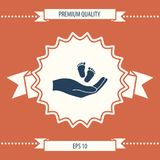 Hands holding baby foot. Signs and symbols - graphic elements for your design Royalty Free Stock Image