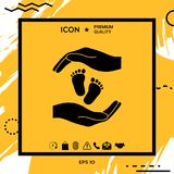 Hands holding baby foot, protection symbol. Element for your design Royalty Free Stock Photos