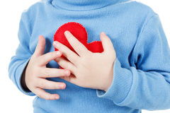 Hands holding baby heart symbol. Concept of love, health and care Royalty Free Stock Photos