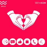 Hands holding baby - protection symbol. Heart shape made with hands. Hands holding baby symbol. Heart shape. . Signs and symbols - graphic elements for your Royalty Free Stock Photography