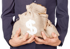 Hands holding bags with coins Royalty Free Stock Image